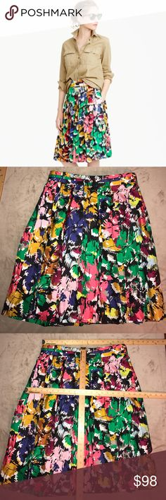 J CREW~Double Pleat Brushstroke Floral Midi Skirt This skirt features double pleats for double the dimension (and fun). Crafted in a pretty swishy silk, it's also covered in an artsy print that was inspired by something J. Crew's designers spotted in upstate New York and then reworked and recolored just for the collection. Up close, it's like an abstract painting, and from far away, it's a bursting floral...in other words, the best kind of optical illusion.  Silk. Back zip. On-seam pockets…