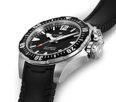 """Hamilton Khaki Navy Frogman 46 mm and 42 mm. Created for the US Navy Underwater Demolition teams, the Hamilton Khaki Navy Frogman was featured in the 1951 """"The Frogmen"""", the first movie about scuba diving as well as the first on-screen appearance for the watch brand founded in 1892. In 2016 Hamilton relaunches the Khaki Navy Frogman in five model variations and two sizes: 46 mm and 42 mm. The 2016 Hamilton Khaki Navy Frogman 46 mm in titanium has a price of Swiss Francs 1,395 / Euro 1,34..."""