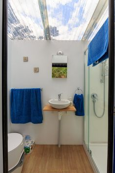 Shower Room. 10 Square Meters Off Grid Shipping Container Tiny House. By Brenda Kelly.