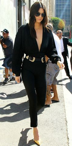 Kendall Jenner has already proven that she's not afraid to take the plunge—and on a sisterly froyo date with Kylie, she took the plunge once again. She stepped out in a navel-grazing long-sleeve black Esosa top with black pants, breaking up the solid mass of black with her go-to Western-inspired belt by B-Low the Belt, aviators, and metallic pumps.