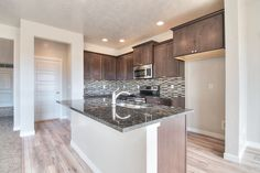 This full kitchen back-splash is LOUD and pairs perfectly by drawing out the accent color in the granite counter tops. A full back-splash is an incredible way to turn up the volume in any kitchen!