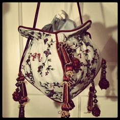 Hand embroidered reticule, linen with cotton embroidery in Crewel style.  Based on a 1800's design. Lined with satin. Maker : Angela Mombers