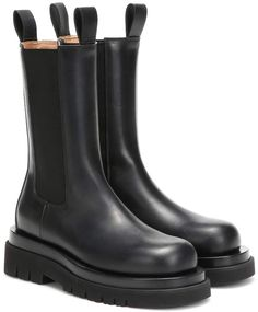 Usher practicality into your wardrobe with these Chelsea-inspired ankle boots from Bottega Veneta. Crafted in Italy, this runway design features a black calf leather upper set on a lugged rubber sole. Black Leather Mules, High Leather Boots, Suede Boots, Black Boots, Women's Boots, Leather Shoes, Boots For Short Women, Short Boots, Buckle Ankle Boots
