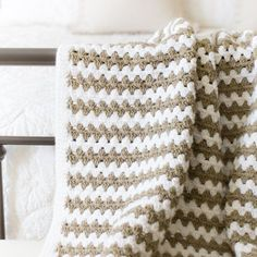 This simple granny stripe afghan is the perfect crochet pattern for a beginner!  It's warm and thick for chilly fall nights!
