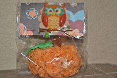 Vintage Autumn Birthday Party: Pumpkin rice krispie treat favors with owl bags.