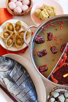 For many of Britain's Asian families, hot pot is an unofficial Christmas tradition: a middle finger to winter's sub-zero temperatures and soggy Brussels sprouts. Hot Pot, Christmas Traditions, Asian, Brussels Sprouts, Eat, Britain, Families, Desserts, Finger