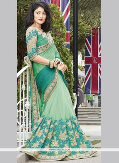 Fashion and trend will be at the peak of your magnificence the moment you dresses this sea green faux chiffon and net designer half n half saree. The appealing embroidered and patch border work a cons...