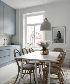 Spacious light blue kitchen - via Coco Lapine Design blog