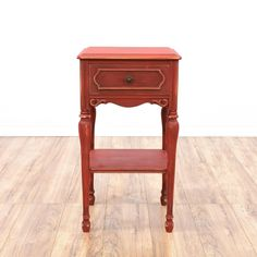 This end table is featured in a solid wood with a distressed red finish. This cottage chic style side table has a single spacious drawer, carved tapered legs and dovetailed joinery. Perfect for storing knicknacks!  #cottagechic #tables #endtable #sandiegovintage #vintagefurniture