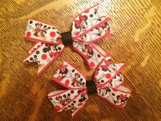 Red minnie mouse hair bows. https://www.etsy.com/listing/230917392/set-of-2-red-minnie-mouse-pigtail-hair?ref=listing-shop-header-2
