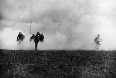 German soldiers flee from a gas attack on the Flanders Front. 1917