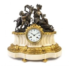 A Louis XVI Style Gilt, Patinated Bronze and Marble Figural Mantel Clock Height 16 x width 16 1/2 inches.