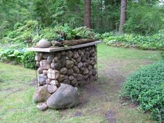 Stone-filled gabion w/slab & rock garden on top! {many more delightful pics on this site}