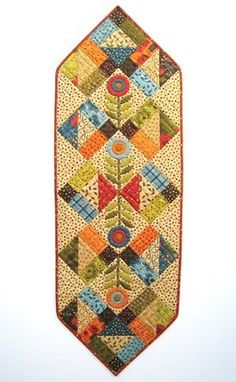 """A Pack of Posies  17"""" x 51"""" – """"This table runner can be made in no time at all with one charm and a half-yard of fabric."""""""