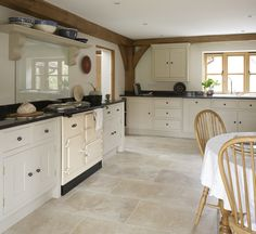 painted kitchen with limestone floor