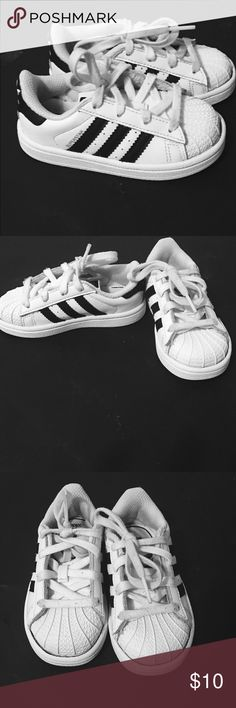 Toddler unisex adidas tennis shoes. Unisex used toddler sneakers some signs of wear but still in good condition. Adidas Shoes Sneakers