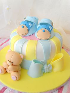 Pastel colors adorn this single tier baby shower cake with bears and booties.