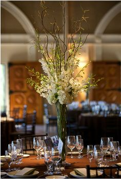 branches centerpiece for wedding - add pops of yellow? - favorite branchy look for high centerpieces