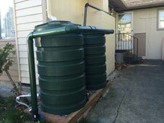 205 gallon tanks and pipes painted to match tank color. Tank surfaces should not be painted as flexing will cause paint to peel off. Screens of plants or fencing recommended to hide tank and piping