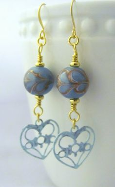 Whether for Valentine's Day or everyday, heart earrings make us feel romantic and sexy. This pair of blue hearts is for the woman who wants to make an unconventional statement.  New in my Etsy shop!