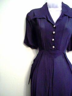 1940s midnight blue chiffon, rhinestone buttons, pockets. Excellent. I'll take it.