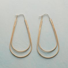 """MAVERICK HOOPS--A stylish take on the ever-loved hoop, fashioned of 14kt gold fill and sporting a long, lovely line inside and out. Sterling silver locking wires. USA. Exclusive. 2-1/4""""L."""
