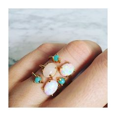 Feminine, delicate and eye-catching stacking ring with a richly colored turquoise stone on one end a lovely iridescent opal on the other end. -18kt gold vermeil -turquoise -opal -fits ring size 6-7 *1