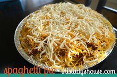 Spaghetti Pie12 oz. Spaghetti, cooked2 c. Cottage Cheese1 lb. Hamburger, cooked, drained2 c. Cheddar Cheese, shredded1 sm. Diced Onion1 jar Spaghetti Sauce2 beaten Eggs1 c. Mozzarella Cheese, shredded
