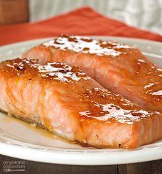 Orange and Bourbon Glazed Salmon: Glazed with a combination of orange marmalade and bourbon whiskey, this easy, oven-roasted salmon makes a terrific weeknight dinner. Bourbon Glazed Salmon, Honey Glazed Salmon Recipe, Orange Glazed Salmon, Baked Salmon Recipes, Fish Recipes, Seafood Recipes, Cooking Recipes, Orange Sauce Recipe For Fish, Orange Salmon Recipes