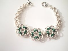 Celtic Flowers and Helm Weave Bracelet by TwingleBeads on Etsy, $28.00 >> Great mix of weaves!