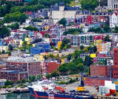 Pin for Later: 19 Unreal Places in Canada You Must See Before You Die Jelly Bean Row, St. John's, Newfoundland and Labrador The downtown area of St. John's is filled with colorful houses totally worthy of a picture. Places Around The World, The Places Youll Go, Places To See, Around The Worlds, Newfoundland Canada, Newfoundland And Labrador, Ottawa, Cinque Terre, Places To Travel