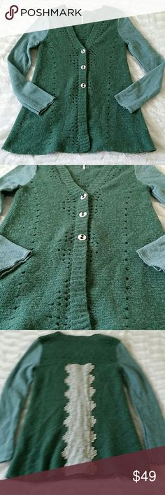 ❄️FP Green Wool Cardigan❄️ Beautiful green cardigan. Wool and cotton with a lace detail in the back. 3 button front. Size small. EUC with only very mild piling to wool. Still very lovely and perfect for the upcoming winter season. Free People Sweaters Cardigans