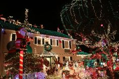 """It's a dark and foggy night - except in the 5600 block of Beach Drive SW, where the Menashe Family Christmas Lights are officially on, shining bright, with visitors already flocking to see them. """"How many lights do you have?"""" one person asked Josh Menashe; no official count, he chee"""