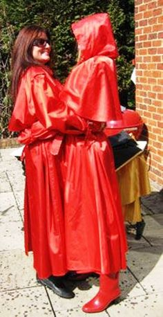 The girls love wearing their red rubberised satin mackintoshes Vinyl Raincoat, Yellow Raincoat, Mackintosh Raincoat, Rubber Raincoats, Rain Hat, Hooded Cloak, Raincoats For Women, Leather Fashion, Outfit