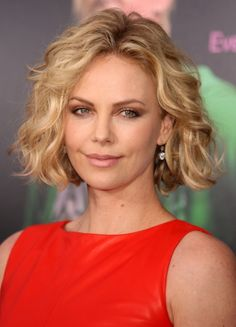 At the New York premiere of 'Young Adult' at the Zigfield Theater, Charlize Theron looked spectacular with her short blonde hair in spiral curls. Description from celebritya.com. I searched for this on bing.com/images