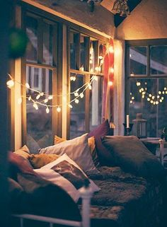 Hygge twinkle lights, pillows, and blankets