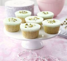 Pistachio cupcakes - simple pistachio cakes with coloured icing, edible glitter and pistachios to decorate. Cupcake Recipes, Cupcake Cakes, Cupcake Ideas, Cookie Recipes, Just Desserts, Delicious Desserts, Pistachio Cupcakes, Yummy Treats, Sweet Treats