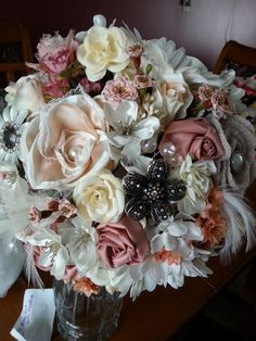 """the bride's bouquet...a combination of silk, handmade and altered fabric flowers, plus brooches and other small bits of """"bling"""""""