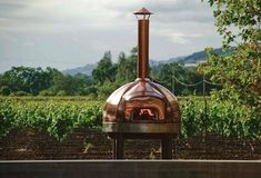 A copper wood-fired oven is used for making pizzas on Saturdays, with toppings from produce in the garden; Medlock Ames in Sonoma