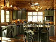 WHAT ABOUT GREEN CABINETS Lindal Cedar Homes: worldwide manufacturer of post and beam homes, solid cedar homes, custom log homes, sunrooms and room additions. Cabin Homes, Log Homes, Lindal Cedar Homes, Log Cabin Kitchens, Rustic Kitchen Design, Cabin In The Woods, Green Kitchen Cabinets, Up House, Diy Décoration