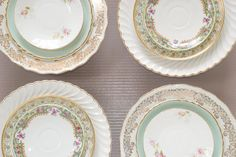"""Set of mismatched porcelain plates. Mismatched porcelain or earthenware plates 