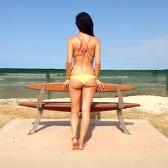 Beach days in the Nalu Cheeky Bottoms in Mango  get yours at www.CACAOBIKINI.com
