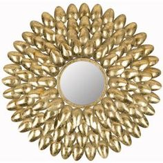 """Showcasing a mirrored central accent and sunburst-inspired antique gold-finished frame, this elegant wall decor brings glamorous appeal to your entryway or master suite.   Product: Wall decorConstruction Material: Iron and mirrored glassColor: Antique gold frameFeatures:  Hand-forgedDimensions: 28"""" Diameter x 1.5"""" D"""