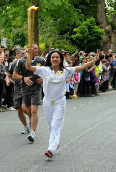 Olympic medalist Michelle Kwan carried the Olympic Flame through Oxford, U.K. on July 10, 2012. Kwan was nominated as an Olympic Torchbearer by The Coca-Cola Company for her role on the Board of Directors for Special Olympics as well as on the President's Council of Fitness, Sports and Nutrition, a group that advises the U.S. President on ways to engage, empower, and educate all Americans to lead active, healthy lifestyles. Photo credit: Michael Pugh.