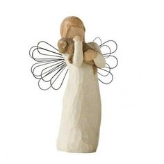 Angel of Friendship www.teeliesfairygarden.com Do you consider someone a true friend? If yes, this angel of friendship is a great gift! You can also make her a centerpiece of your holiday inspired garden. #fairyangel