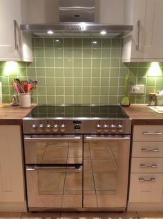 Julie's stunning green tiled kitchen and Stoves Sterling range cooker and hood in stainless steel - look at that sparkling (and spacious) cooker finish!