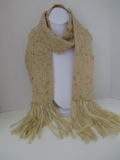"""Beaded woven scarf    Champagne & glitz! The beads were strung individually and woven into beautiful, shimmering champagne colored ribbons. Lightweight and a gorgeous accent accessory. It measures 4.25"""" x 66""""(including fringe).    #Scarf #GoldScarf #handmade #americanmade www.aftcra.com"""