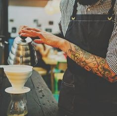 .I like a man with tattoos...pouring coffee....in an apron