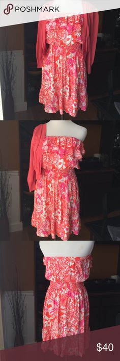 "Lilly Pulitzer strapless mini dress Beautiful strapless flowy dress by Lily Pulitzer.  Great dress to dress up or down.  Below the bust to hem is 19"".   Colors are fuchsia, coral, light coral and white. Lily Pulitzer  Dresses Strapless"