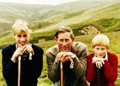"""Charles, the Prince of Wales (center) is flanked by his two sons, Princes William or """"Wills"""" (l) and Henry or """"Harry."""" This photo, taken by the boys' nanny at the royal estate Balmoral in Scotland, was their 1996 Christmas card. In that year, Prince Charles and Princess Diana divorced."""